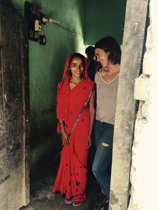 Preeti, a married, mother of two from Masnapur Village in India, leads actress,singer/songwriter and PSI Global Ambassador Mandy Moore to the toilet she.pressed her husband and his family to purchase. PSI has helped build and finance more than 16,000 toilets in the Bihar region of India..