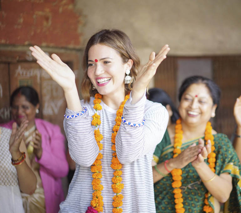 Actress, singer-songwriter and PSI Global Ambassador Mandy Moore arrived to music and celebration at a community meeting in Samodhipur, Indira Nagar, an urban slum in Lucknow. The women gather monthly to hear from a doctor monthly.