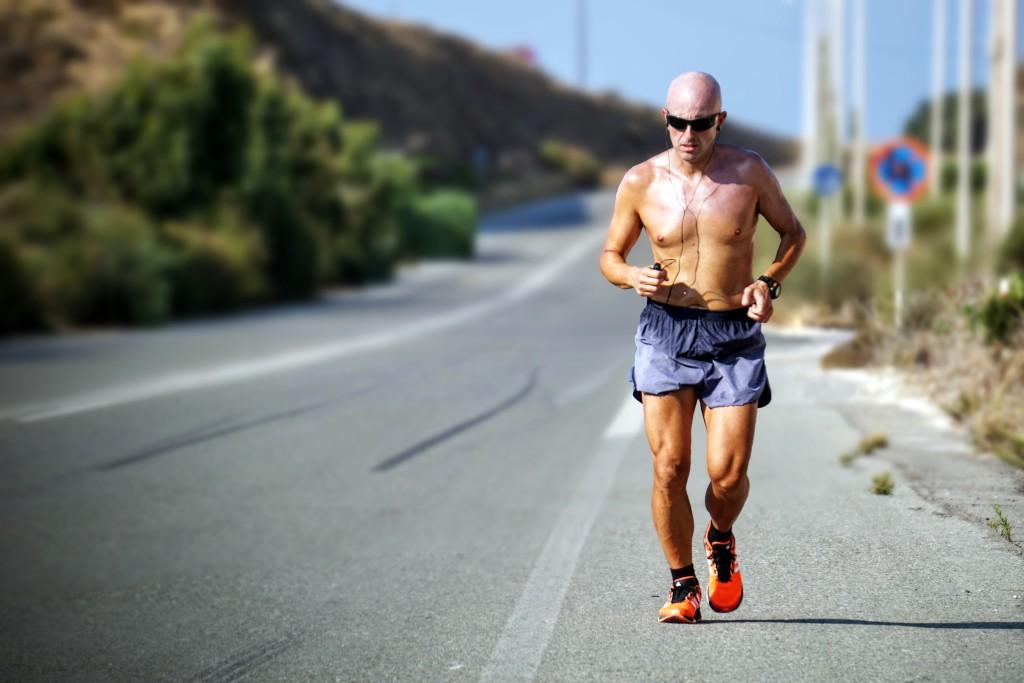 man-jogging-on-side-of-road